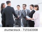 handshake of business partners... | Shutterstock . vector #715163308