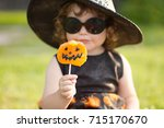 little stylish witch outdoors ... | Shutterstock . vector #715170670