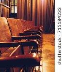 antique vintage wooden seats in ... | Shutterstock . vector #715184233