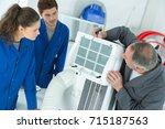 appliance technician inspecting ... | Shutterstock . vector #715187563