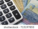 close up of a calculator and... | Shutterstock . vector #715197853