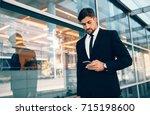 business traveler looking at... | Shutterstock . vector #715198600