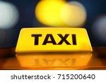 3d rendering yellow taxi sign... | Shutterstock . vector #715200640