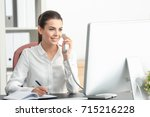 young female receptionist... | Shutterstock . vector #715216228