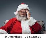 sad santa claus having an... | Shutterstock . vector #715230598
