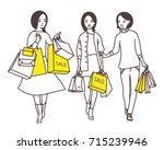 ladies go down the street with...   Shutterstock .eps vector #715239946