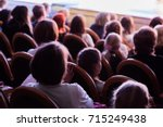 the audience in the theater... | Shutterstock . vector #715249438