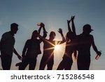 people dancing in summer | Shutterstock . vector #715286548
