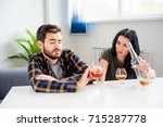 couple drinking together | Shutterstock . vector #715287778