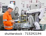 engineer programing automated... | Shutterstock . vector #715292194