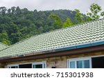 green tile roof and sky with... | Shutterstock . vector #715301938