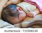 breastfeeding newborn in... | Shutterstock . vector #715308130