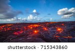 active lava flow and cracks | Shutterstock . vector #715343860