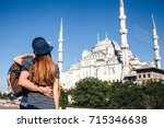 a couple of tourists a young... | Shutterstock . vector #715346638