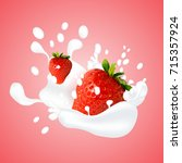 strawberry splashing in milk on ... | Shutterstock . vector #715357924