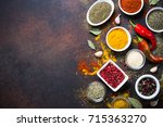 various spices in a bowls on... | Shutterstock . vector #715363270
