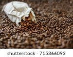 fresh roasted coffee beans and... | Shutterstock . vector #715366093