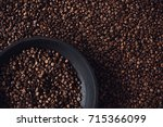roasted coffee beans on black... | Shutterstock . vector #715366099