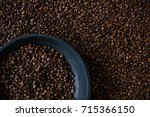 roasted coffee beans on black... | Shutterstock . vector #715366150