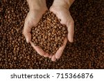 man's hands holding coffee beans | Shutterstock . vector #715366876