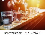 close up on vodka shots and... | Shutterstock . vector #715369678