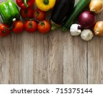 assorted colourful vegetables... | Shutterstock . vector #715375144