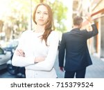 Small photo of Disappointed young brunette in quarrel with her boyfriend background