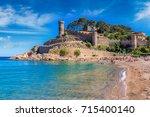 beach at tossa de mar and... | Shutterstock . vector #715400140