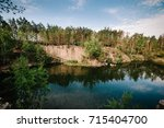 lake on the background of rocks ...   Shutterstock . vector #715404700