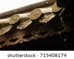 Small photo of Details of ornamentation and decorations in a traditional asian style roof.