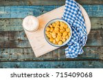 tasty lupins in metal mug and... | Shutterstock . vector #715409068