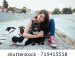 Stock photo dog walker with dogs enjoying outdoors next to city river selective focus on french bulldog 715415518
