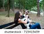 Stock photo dog walker with dogs enjoying in park 715415659