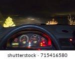 car dashboard in the night  ... | Shutterstock . vector #715416580