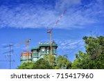 building crane and building... | Shutterstock . vector #715417960