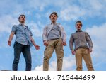 low angle photo of three guys... | Shutterstock . vector #715444699