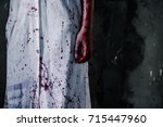 bloody hand of ghost woman in... | Shutterstock . vector #715447960