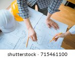 group of architect working on... | Shutterstock . vector #715461100