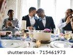 gay couple hands cutting... | Shutterstock . vector #715461973