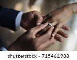 groom put on wedding ring bride ... | Shutterstock . vector #715461988