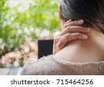 woman put her hand on the back...   Shutterstock . vector #715464256