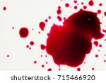 blood drops on white background | Shutterstock . vector #715466920