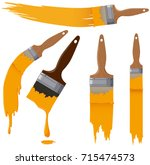 paintbrushes with yellow paint... | Shutterstock .eps vector #715474573