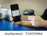 a barcode scanner scanning a...