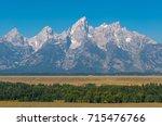the grand teton granite peaks... | Shutterstock . vector #715476766