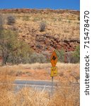 Small photo of Warning sign for Kangaroo crossing at the Ormiston Gorge access road, west MacDonnell ranges near Alice Springs, Northern Territory, Australia
