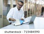 professional matured lawyer... | Shutterstock . vector #715484590