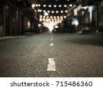 a asphalt road with orange...   Shutterstock . vector #715486360