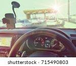 car dashboard in traffic ... | Shutterstock . vector #715490803