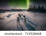 a team of six husky sled dogs... | Shutterstock . vector #715528468